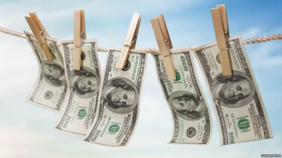 Money Laundering. Hanging $100 bills