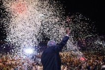 """Newly elected Mexico's President Andres Manuel Lopez Obrador, running for """"Juntos haremos historia"""" party, cheers his supporters at the Zocalo Square after winning general elections, in Mexico City, on July 1, 2018. / AFP PHOTO / ALFREDO ESTRELLA"""